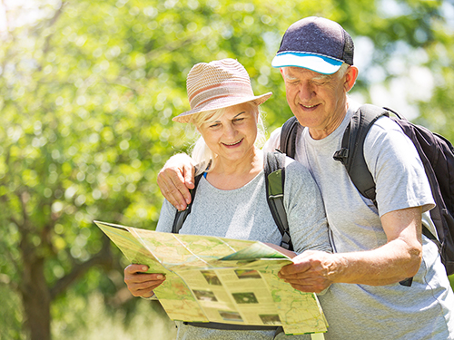 Active adult couple out for a local hike>