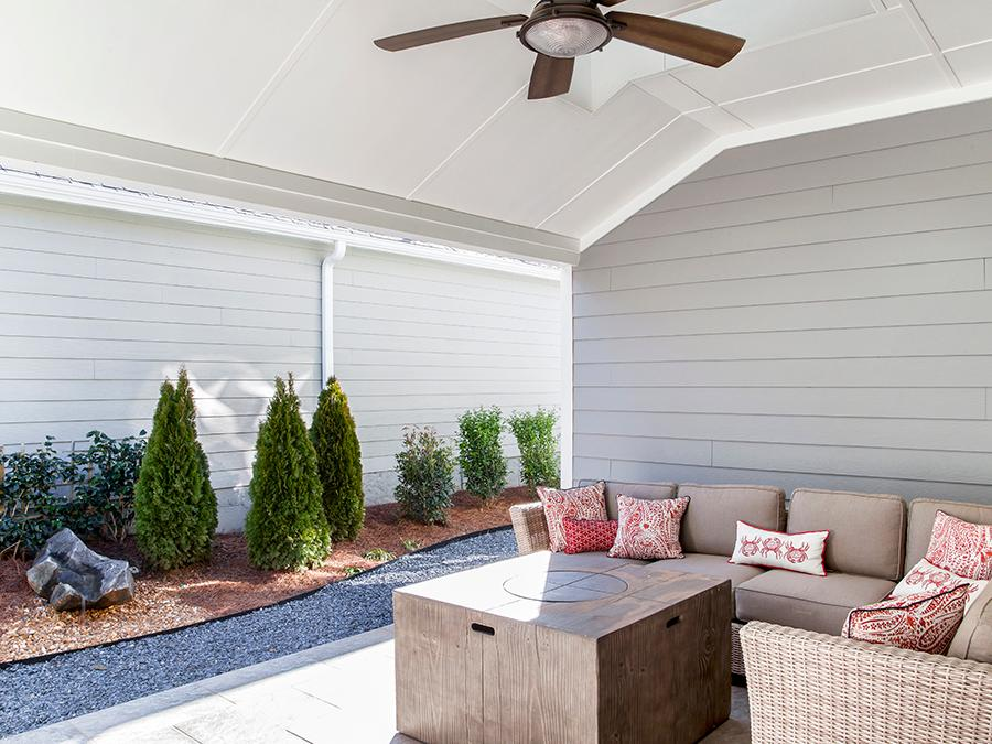 Cozy side patio with lots of space and shade in the Harrison new home plan available at the McConnell Green 55 and older community in Powder Springs, GA.