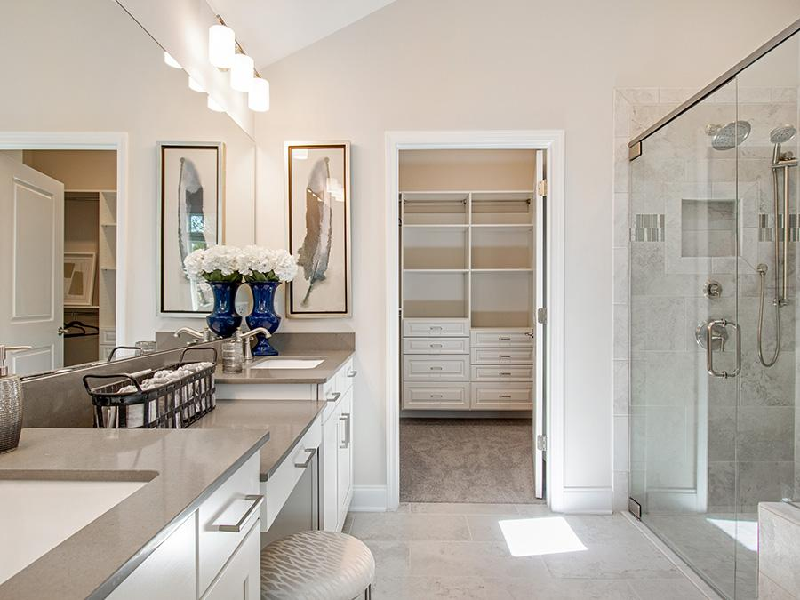 Treat yourself to a spa day at home with elegant walk-in showers with bench seating.