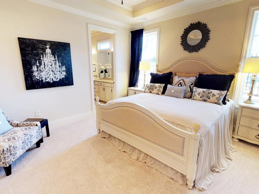 The first floor master suite of The Camden at Linton & Main in downtown Woodstock, GA features a features an elegant design.