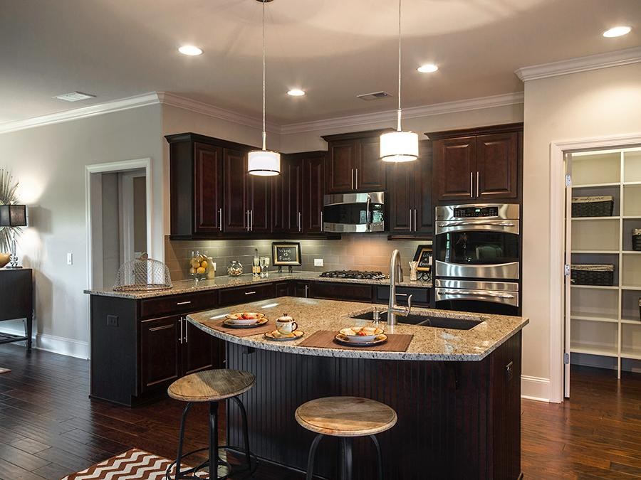 Enjoy a quick breakfast in your beautiful island kitchen at the Windsong Manor 55+ active adult community in Dallas, GA before heading out for a game of tennis.