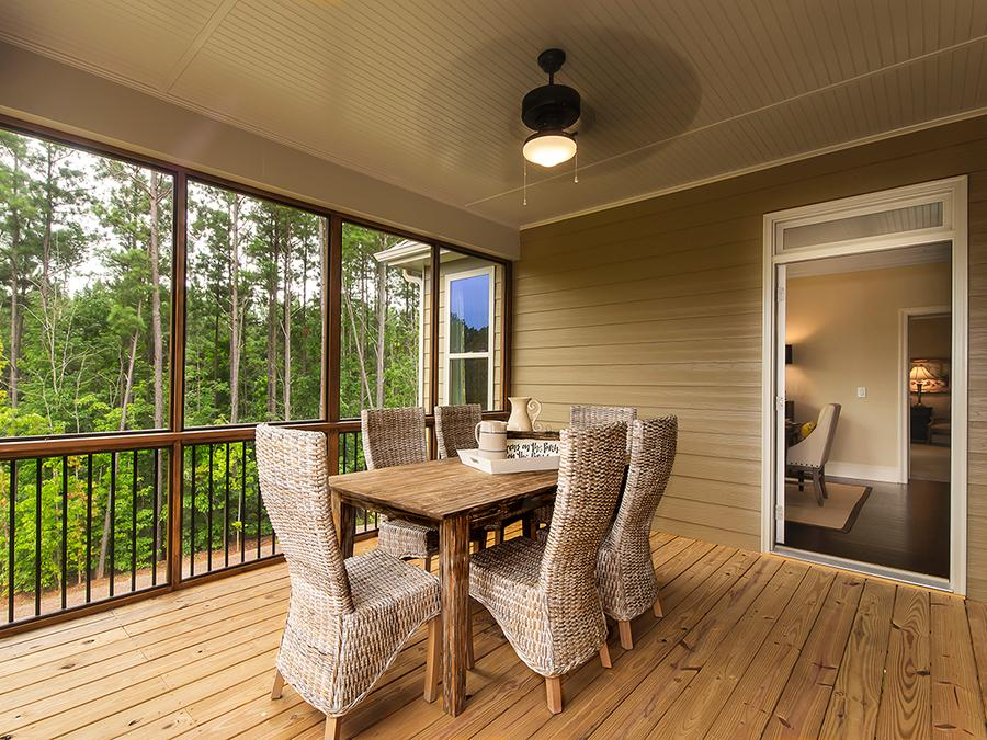 Enjoy dinner outdoors in the cozy private retreat of The Bentley's screen porch at the Windsong Manor 55+ community in Dallas, GA.